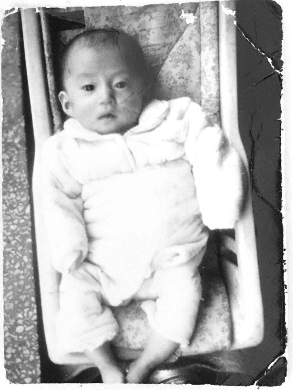 An adoption referral photograph of an infant up for adoption from 1975.