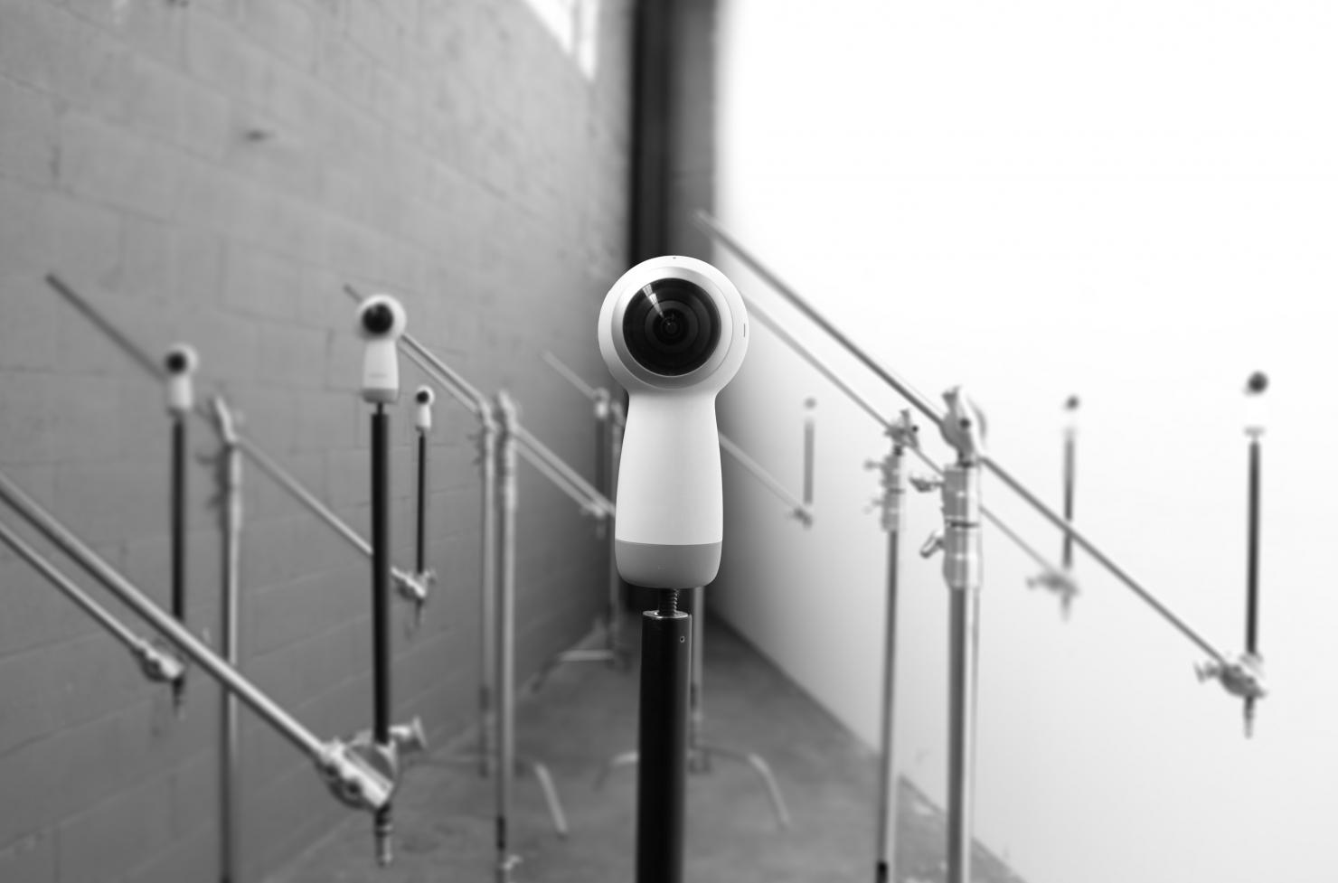Several cameras that appear to be futuristic are poised to look straight on a the viewer