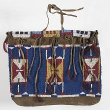<a href='http://collection.spencerart.ku.edu/eMuseumPlus?service=ExternalInterface&module=collection&objectId=37562&viewType=detailView' target='_blank'><i>beaded bag</i> by Cheyenne or Lakota peoples</a>