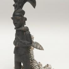 <a href='http://collection.spencerart.ku.edu/eMuseumPlus?service=ExternalInterface&module=collection&objectId=35523&viewType=detailView' target='_blank'><i>Eshu figure with shell attachments</i> by Oyo peoples</a>
