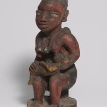<a href='http://collection.spencerart.ku.edu/eMuseumPlus?service=ExternalInterface&module=collection&objectId=35392&viewType=detailView' target='_blank'><i>mother with children figure</i> by Oyo peoples</a>