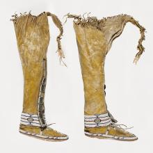 <a href='http://collection.spencerart.ku.edu/eMuseumPlus?service=ExternalInterface&module=collection&objectId=33408&viewType=detailView' target='_blank'><i>pair of beaded boots</i> by Arapaho or Cheyenne peoples</a>