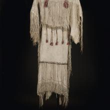 <a href='http://collection.spencerart.ku.edu/eMuseumPlus?service=ExternalInterface&module=collection&objectId=32097&viewType=detailView' target='_blank'><i>three-hide dress</i> by Kiowa peoples</a>