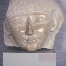 "<a href=""https://spencerartapps.ku.edu/collection-search#/object/10233"" target=""_blank""><i>head from a sarcophagus</i> by Egypt</a>"