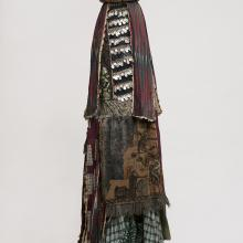 "<a href=""https://spencerartapps.ku.edu/collection-search#/object/34417"" target=""_blank""><i>egungun mask</i> by Oyo peoples</a>"