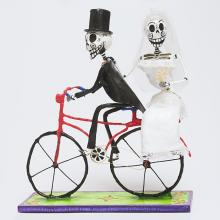 <a href='http://collection.spencerart.ku.edu/eMuseumPlus?service=ExternalInterface&module=collection&objectId=38204&viewType=detailView' target='_blank'><i>bride and groom skeletons on a bicycle</i> by Mexico</a>