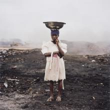 "<a href=""https://spencerartapps.ku.edu/collection-search#/object/43821"" target=""_blank""><i>Naasra Yeti, Agbogbloshie Market, Accra, Ghana</i> by Pieter Hugo</a>"