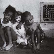 "<a href=""https://spencerartapps.ku.edu/collection-search#/object/18184"" target=""_blank""><i>black children with white doll</i> by Gordon Parks</a>"