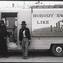 <a href='http://collection.spencerart.ku.edu/eMuseumPlus?service=ExternalInterface&module=collection&objectId=54836&viewType=detailView' target='_blank'><i>untitled (two chimney sweepers in front of a truck)</i> by Thaddeus Holownia</a>