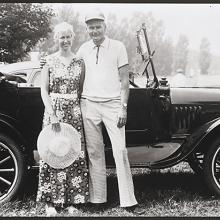 <a href='http://collection.spencerart.ku.edu/eMuseumPlus?service=ExternalInterface&module=collection&objectId=54861&viewType=detailView' target='_blank'><i>untitled (couple posing in front of a convertible buggy)</i> by Thaddeus Holownia</a>