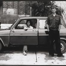 <a href='http://collection.spencerart.ku.edu/eMuseumPlus?service=ExternalInterface&module=collection&objectId=54865&viewType=detailView' target='_blank'><i>untitled (two young men posing with car)</i> by Thaddeus Holownia</a>