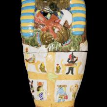 <a href='http://collection.spencerart.ku.edu/eMuseumPlus?service=ExternalInterface&module=collection&objectId=12084&viewType=detailView' target='_blank'><i>The Mummy of Frogtosis, II (Frog Mummy)</i> by David James Gilhooly</a>
