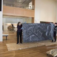 Artist Sandy Winters and Head of Collections Sofia Galarza Liu delicately transport a portion of Winters's mural-sized installation <i>Long Night's Journey into Day</i>