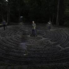 Army veteran Jay Waldo, co-creator of a veteran mental health program called Warriors' Ascent, stands in the middle of a labyrinth as others make their way through the maze. Photographed by Steve Gibson