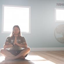 Air Force veteran Kerry Dean Steuart sits in his own yoga studio in Kansas City. Photographed by John Howe